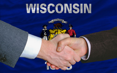 in front of american state flag of west wisconsin two businessme