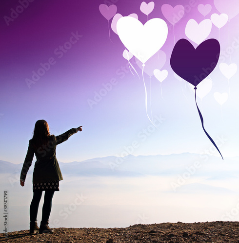 Girl showing  valentine hearts in the sky