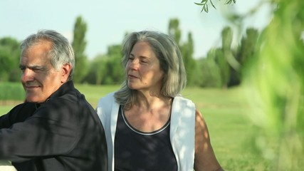 Happy senior couple relaxing in the nature; Full HD Photo JPEG