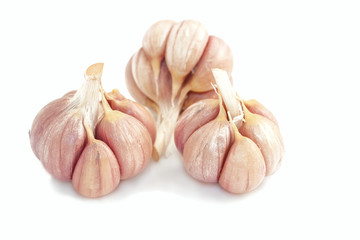 Three bulbs of garlic isolated on white background