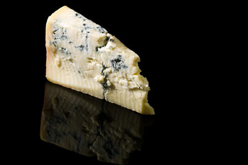 Piece gorgonzola cheese isolated on black with reflection