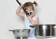 studio shot of young cooking girl