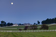 Moon over horse farm