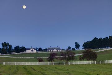 Moon over horse farm