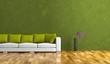 Wohndesign - weisses Sofa vor grüner Wand