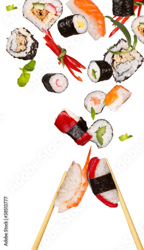 Sushi pices flying on white background - 38513777