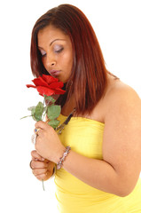 Girl smelling the rose.