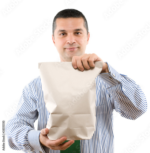 Adult man holding recycled shopping bag isolated on white.