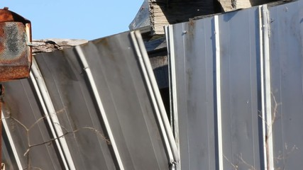 Section Of Tin Building Flapping In Wind