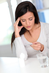 Woman taking drugs to releave headache