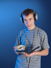 The teenager listens to music