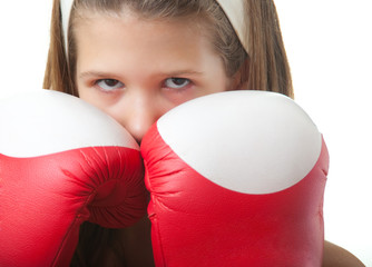 Pretty teenage girl posing with boxing gloves