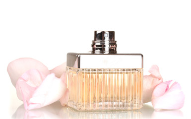 perfume in a beautiful bottle and petals  isolated on white