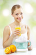 Girl with a juicer and orange juice