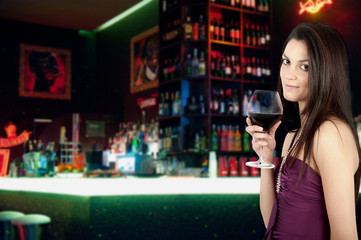 Attractive girl drinking wine