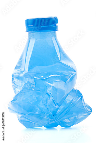 Squashed plastic bottle ready to recycle.