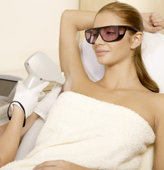 Young woman receiving laser therapy