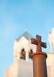крест на фоне церковной колокольни