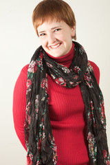 Smiling redhead woman in studio