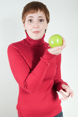 Quirky woman holding apple