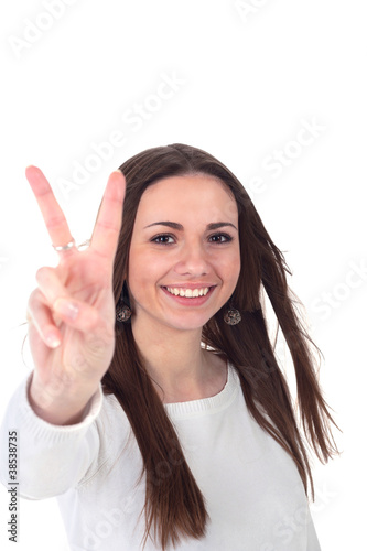 happy excited young woman showing the sign of victory