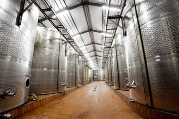 modern wine factory with large storage tanks