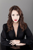 Beautiful brunette serious seductress woman in black casual poster