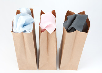 Clothes In Brown Paper Bags
