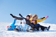 Parents and kids on snowy hill