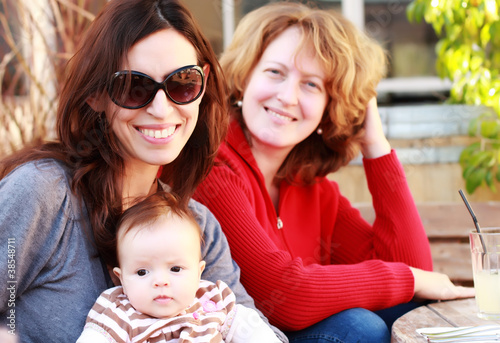 two beautiful girls with a baby outdoor