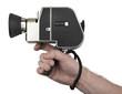 Hand holding a camera super 8