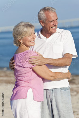 Happy Senior Couple Embracing on Beach