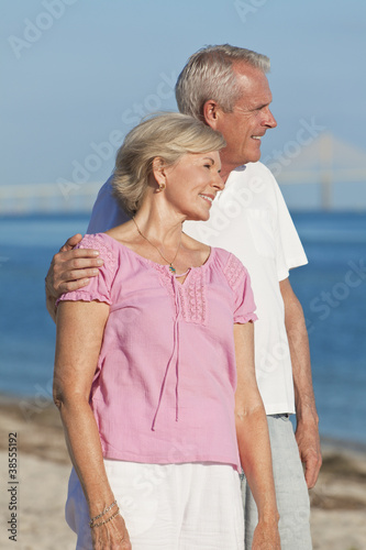Happy Romantic Senior Couple Embracing on Beach