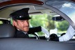 Smiling chauffeur in limousine