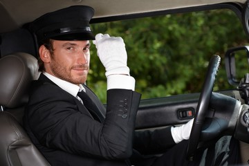 Confident chauffeur in elegant automobile