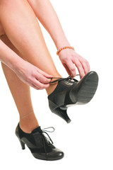 Woman tie her shoes