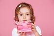 Girl holding present box