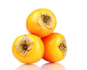 Three appetizing persimmons isolated on white