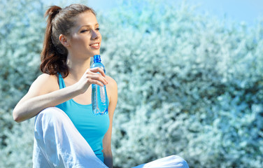 Beautiful Fitness Woman Drinking Water