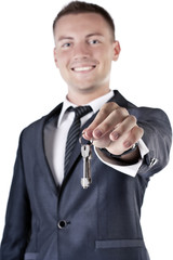 Business man giving you the keys to a home