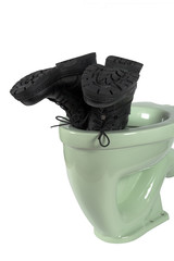 Men's shoes and light green toilet (isolated)