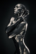 Nude woman like statue in liquid metal