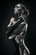 Nude woman like statue in liquid metal