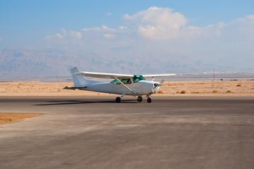 White Cessna-172 plane on the desert aerodrome