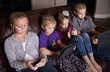 Kids using Mobile Devices - 38573190