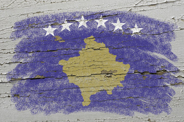 flag of kosovo on grunge wooden texture precise painted with cha