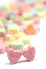 Little colorful candy hearts on white background. Shallow dof