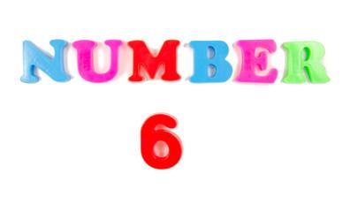 number 6 written in fridge magnets