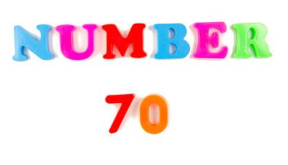number 70 written in fridge magnets
