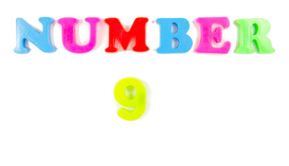 number 9 written in fridge magnets
